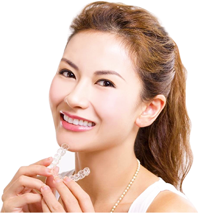 A smiling woman holding a dental retainer