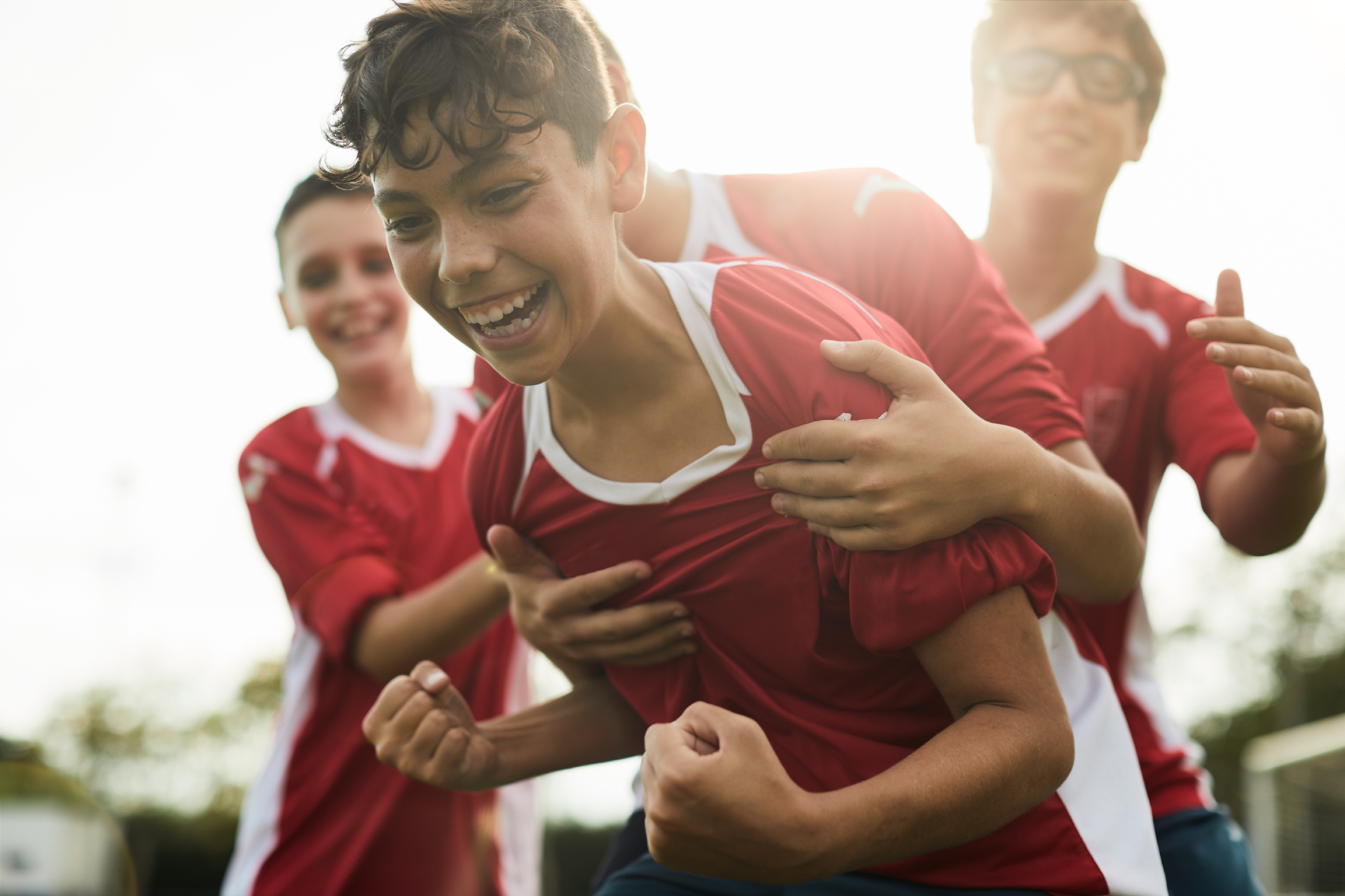Teenager Playing Soccer Invisalign